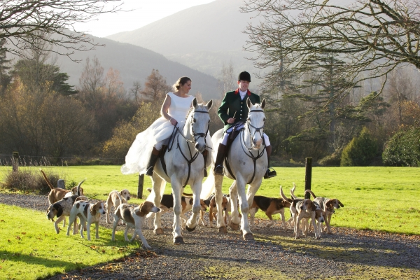 Huntsmand and Bride on Horse and Hounds photographer Ireland Professional Ni Riain Fine Art Equine Photography